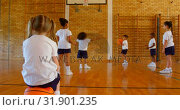 Купить «Schoolgirl sitting on basketball in basketball court at school 4k», видеоролик № 31901235, снято 10 ноября 2018 г. (c) Wavebreak Media / Фотобанк Лори