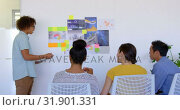 Купить «Young mixed-race male executive explaining about graphs and sticky notes in modern office 4k», видеоролик № 31901331, снято 18 ноября 2018 г. (c) Wavebreak Media / Фотобанк Лори