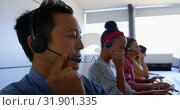 Купить «Multi-ethnic customer sales executives talking on headset in modern office 4k», видеоролик № 31901335, снято 18 ноября 2018 г. (c) Wavebreak Media / Фотобанк Лори