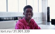 Купить «Handsome African american male executive sitting in the lobby at modern office 4k», видеоролик № 31901339, снято 18 ноября 2018 г. (c) Wavebreak Media / Фотобанк Лори