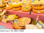 Купить «Dutch cheese assortment is on a counter», фото № 31901599, снято 25 февраля 2017 г. (c) EugeneSergeev / Фотобанк Лори