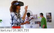 Купить «Pretty mixed-race female executives using virtual reality headset in modern office 4k», видеоролик № 31901731, снято 18 ноября 2018 г. (c) Wavebreak Media / Фотобанк Лори