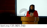 Купить «Mature Caucasian hijab businesswoman speaking at podium in auditorium 4k», видеоролик № 31901743, снято 15 ноября 2018 г. (c) Wavebreak Media / Фотобанк Лори