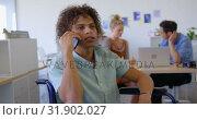 Купить «Young mixed-race disabled male executive talking to his mobile phone in office 4k», видеоролик № 31902027, снято 18 ноября 2018 г. (c) Wavebreak Media / Фотобанк Лори