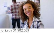 Купить «Pretty mixed-race female executive smiling at desk in modern office 4k», видеоролик № 31902039, снято 18 ноября 2018 г. (c) Wavebreak Media / Фотобанк Лори