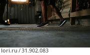 Купить «African American male boxer practicing foot movements with trainer in gym 4k», видеоролик № 31902083, снято 17 октября 2018 г. (c) Wavebreak Media / Фотобанк Лори