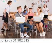 Купить «Students enjoying free time in class», фото № 31902315, снято 25 июля 2018 г. (c) Яков Филимонов / Фотобанк Лори