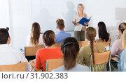 Купить «Mature female giving presentation for students», фото № 31902383, снято 19 августа 2019 г. (c) Яков Филимонов / Фотобанк Лори