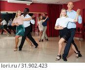 Купить «Adult couples dancing salsa dance together in modern studio», фото № 31902423, снято 4 октября 2018 г. (c) Яков Филимонов / Фотобанк Лори