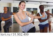 Купить «Group of multinational smiling adult people enjoying active dance movement», фото № 31902499, снято 30 июля 2018 г. (c) Яков Филимонов / Фотобанк Лори