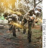 Купить «Portrait of team of adult people playing on paintball battlefiel», фото № 31902703, снято 22 сентября 2018 г. (c) Яков Филимонов / Фотобанк Лори