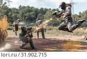 Купить «Dynamic paintball battle. Portrait female player jumping and aim», фото № 31902715, снято 22 сентября 2018 г. (c) Яков Филимонов / Фотобанк Лори
