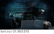 Купить «Hacker using computer in dark room with code », видеоролик № 31903015, снято 22 января 2019 г. (c) Wavebreak Media / Фотобанк Лори
