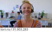 Купить «Pretty Caucasian female executive in headset sitting at desk 4k», видеоролик № 31903283, снято 18 ноября 2018 г. (c) Wavebreak Media / Фотобанк Лори