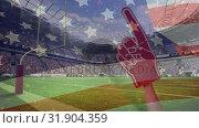 American football fan using red foam finger to support American football players and American flag w. Стоковое видео, агентство Wavebreak Media / Фотобанк Лори