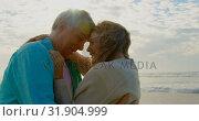 Купить «Side view of active senior Caucasian couple embracing each other on the beach 4k», видеоролик № 31904999, снято 14 ноября 2018 г. (c) Wavebreak Media / Фотобанк Лори