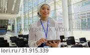 Купить «Asian businesswoman holding digital tablet in the lobby at office 4k», видеоролик № 31915339, снято 21 ноября 2018 г. (c) Wavebreak Media / Фотобанк Лори