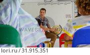 Купить «Front view of Caucasian male teacher teaching schoolkids about globe in the classroom 4k», видеоролик № 31915351, снято 17 ноября 2018 г. (c) Wavebreak Media / Фотобанк Лори