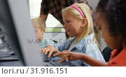 Купить «Side view of Caucasian schoolgirl studying on personal computer male teacher teaching schoolkids in », видеоролик № 31916151, снято 17 ноября 2018 г. (c) Wavebreak Media / Фотобанк Лори