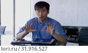 Купить «Front view of Asian male executive interacting in the office 4k», видеоролик № 31916527, снято 18 ноября 2018 г. (c) Wavebreak Media / Фотобанк Лори