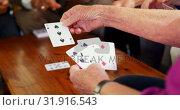 Купить «Mid section of senior people playing cards at nursing home 4k», видеоролик № 31916543, снято 22 ноября 2018 г. (c) Wavebreak Media / Фотобанк Лори