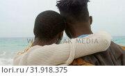 Купить «Rear view of African american couple embracing each other on the beach 4k», видеоролик № 31918375, снято 12 ноября 2018 г. (c) Wavebreak Media / Фотобанк Лори