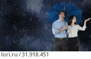 Happy couple holding an umbrella under the rain. Стоковое видео, агентство Wavebreak Media / Фотобанк Лори