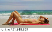 Купить «Side view of Caucasian woman relaxing on the beach 4k», видеоролик № 31918859, снято 12 ноября 2018 г. (c) Wavebreak Media / Фотобанк Лори
