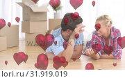 Купить «Couple unpacking at new house», видеоролик № 31919019, снято 13 февраля 2019 г. (c) Wavebreak Media / Фотобанк Лори