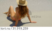 Купить «Rear view of Caucasian woman relaxing on the beach 4k», видеоролик № 31919259, снято 12 ноября 2018 г. (c) Wavebreak Media / Фотобанк Лори