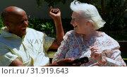 Купить «Front view of active mixed-race senior couple using mobile phone in the garden of nursing home 4k», видеоролик № 31919643, снято 22 ноября 2018 г. (c) Wavebreak Media / Фотобанк Лори