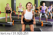 Купить «Group of females exercising with barbell workout», фото № 31920251, снято 26 июля 2017 г. (c) Яков Филимонов / Фотобанк Лори