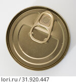 Купить «Close-up of metal bronze tin can with ring pull on white background», фото № 31920447, снято 24 августа 2019 г. (c) Яков Филимонов / Фотобанк Лори