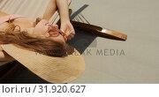 Купить «High angle view of Caucasian woman relaxing in a hammock at beach 4k», видеоролик № 31920627, снято 12 ноября 2018 г. (c) Wavebreak Media / Фотобанк Лори