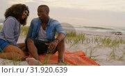 Купить «Front view of African american couple interacting each other on the beach 4k», видеоролик № 31920639, снято 12 ноября 2018 г. (c) Wavebreak Media / Фотобанк Лори
