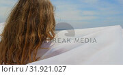 Купить « Rear view of Caucasian woman wrapped in sarong on the beach 4k», видеоролик № 31921027, снято 12 ноября 2018 г. (c) Wavebreak Media / Фотобанк Лори