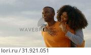 Купить «Low angle view of African american man giving piggyback ride to woman on the beach 4k», видеоролик № 31921051, снято 12 ноября 2018 г. (c) Wavebreak Media / Фотобанк Лори