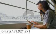 Купить «Businesswoman using digital tablet near window in a modern office 4k», видеоролик № 31921271, снято 6 декабря 2018 г. (c) Wavebreak Media / Фотобанк Лори