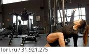 Купить «Woman exercising in fitness studio 4k», видеоролик № 31921275, снято 26 июня 2018 г. (c) Wavebreak Media / Фотобанк Лори
