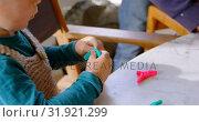 Купить «Little boy playing with clay in a comfortable home 4k», видеоролик № 31921299, снято 28 мая 2018 г. (c) Wavebreak Media / Фотобанк Лори