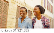 Купить «Twin sisters walking together in the city 4k», видеоролик № 31921335, снято 6 мая 2018 г. (c) Wavebreak Media / Фотобанк Лори