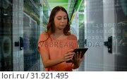 Купить «Woman browsing on a tablet», видеоролик № 31921495, снято 5 марта 2019 г. (c) Wavebreak Media / Фотобанк Лори