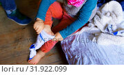 Купить «Boy wearing socks in bedroom at home 4k», видеоролик № 31922099, снято 28 мая 2018 г. (c) Wavebreak Media / Фотобанк Лори