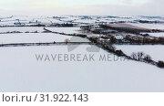 Купить «Beautiful snowy landscape during winter 4k», видеоролик № 31922143, снято 28 марта 2018 г. (c) Wavebreak Media / Фотобанк Лори