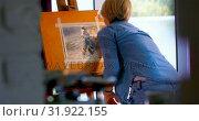 Купить «Female painter painting on a canvas at home 4k», видеоролик № 31922155, снято 9 марта 2018 г. (c) Wavebreak Media / Фотобанк Лори