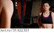 Купить «Woman exercising with dumbbells in fitness studio 4k», видеоролик № 31922551, снято 26 июня 2018 г. (c) Wavebreak Media / Фотобанк Лори