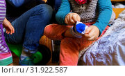 Купить «Boy putting socks on in bedroom at home 4k», видеоролик № 31922587, снято 28 мая 2018 г. (c) Wavebreak Media / Фотобанк Лори