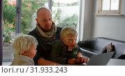 Купить «Father and children using laptop at home 4k», видеоролик № 31933243, снято 28 мая 2018 г. (c) Wavebreak Media / Фотобанк Лори