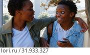 Купить «Twin sisters walking in the city 4k  », видеоролик № 31933327, снято 6 мая 2018 г. (c) Wavebreak Media / Фотобанк Лори