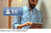 Купить «Profile icon and a man using a tablet in the locker area», видеоролик № 31933527, снято 26 марта 2019 г. (c) Wavebreak Media / Фотобанк Лори